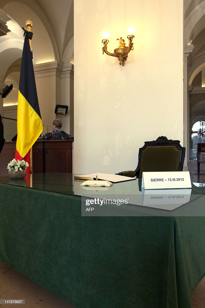 The Belgian flag is pictured next to the condolences register of the Chamber at the federal parliament for the victims of the March 13 bus crash in Switzerland on March 15, 2012 in Brussels. Today, the Chamber will not follow the normal proceedings of question time, after the bus accident in Sierre, in which 28 people, including 22 children from schools in Heverlee and Lommel, were killed. Belgium has declared a national day of mourning for Friday after the bus crash in the Swiss Alps which killed 22 children. A minute's silence will be observed at 11:00 am (1000 GMT) in schools, public offices and across the country with flags at half mast and ceremonies planned into the weekend, the government announced.