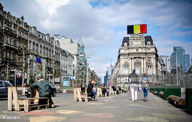 The Belgian national colours are seen on a billboard at the Place de Brouckere square in the city center of Brussels on March 22 in Brussels...
