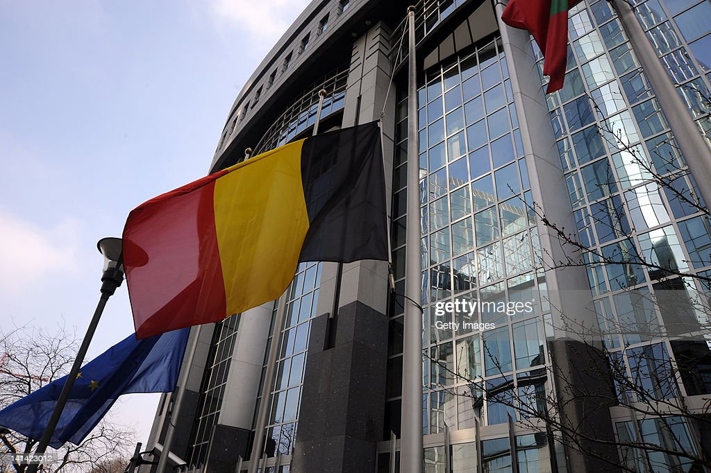 The Belgian national flag flies at half mast outside the European Parliament building, following a coach crash which killed 28 people March 16, 2012 in Brussels, Belgium. A minute's silence is being observed in Belgium today for the victims. The accident occurred when a school bus carrying 11 -12 year olds, returning from a skiing holiday, crashed into a tunnel wall, killing 28 of the 52 passengers.
