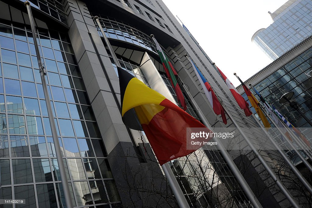 The Belgian national flag flies at half mast, outside the European Parliament building, following a coach crash which killed 28 people March 16, 2012 in Brussels, Belgium. A minute's silence is being observed in Belgium today for the victims. The accident occurred when a school bus carrying 11 -12 year olds, returning from a skiing holiday, crashed into a tunnel wall, killing 28 of the 52 passengers.