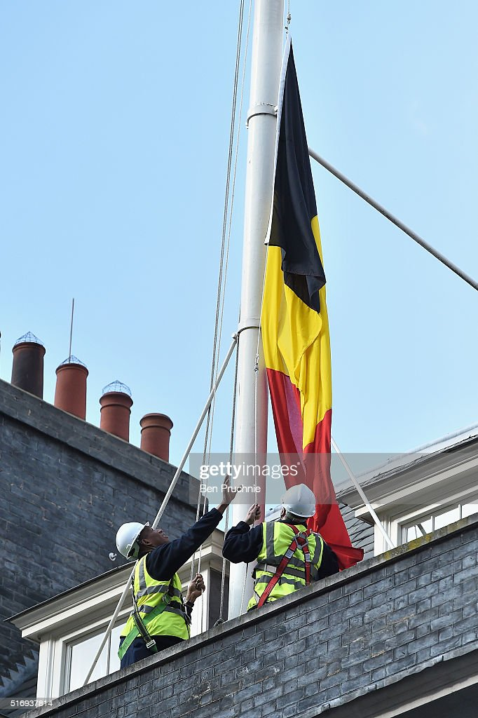 The Belgian national flag is raised as a mark of respect at Downing Street on March 22, 2016 in London, England. At least 34 people are thought to have been killed after Brussels airport and a Metro station were targeted by explosions. The attacks come just days after a key suspect in the Paris attacks, Salah Abdeslam, was captured in Brussels.