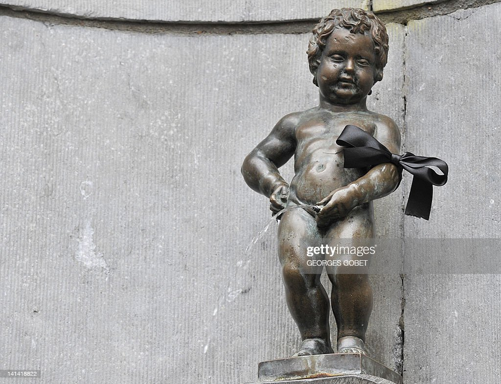 The Belgian statue Manneken Pis wearing a black arm band on March 16, 2012. Belgium observes a national day of mourning for the victims of the March 13 bus crash near the town of Sierre in southern Switzerland. Twenty-eight people died in the crash, including 22 children from two schools of Lommel and Heverlee, who were returning to Belgium from a skiing holiday. The first survivors of the accident returned to Belgium on March 16 .