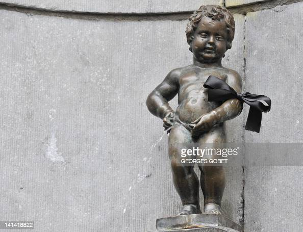 The Belgian statue Manneken Pis wearing a black arm band on March 16 2012 Belgium observes a national day of mourning for the victims of the March 13...