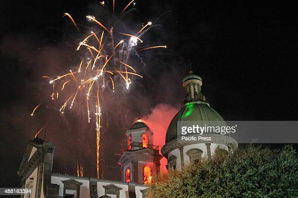 The Bell Tower of the Marian Shrine surrounded by fireworks with many colors The simulated 'Incendio del Campanile' of the Marian Shrine is a high...