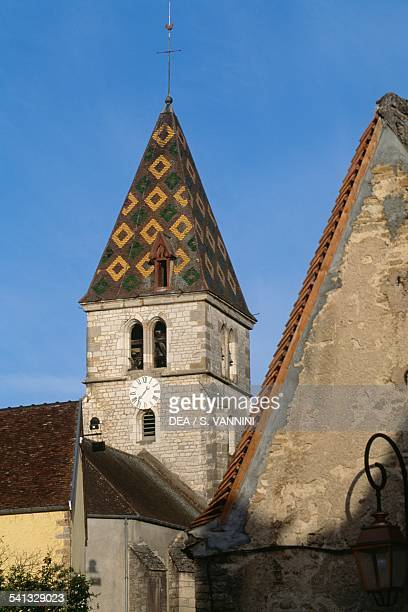 The bell tower with polychrome tile roof of Cuchey church Coted'Or Burgundy France