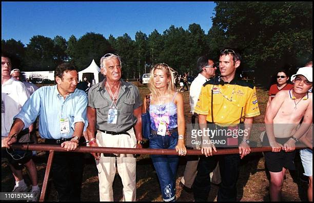The Belmondo family at the '24 heures du Mans' racing tournament in Le Mans France on June 17 2000 Michel Drucker JeanPaul Belmondo Natty Paul...