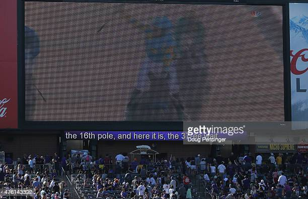 The Belmont Stakes is shown on the jumbotron live as American Pharoah wins the triple crown while the Miami Marlins face the Colorado Rockies at...