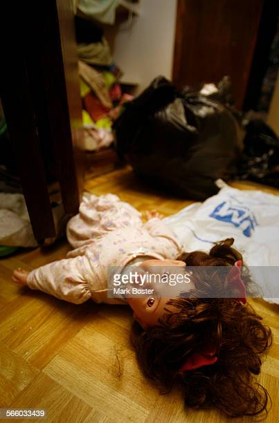 The belongings of a family living in a small house owned by Oscar Hernandez Mayor of the City Of Bell still lay strewn around after a Los Angeles...