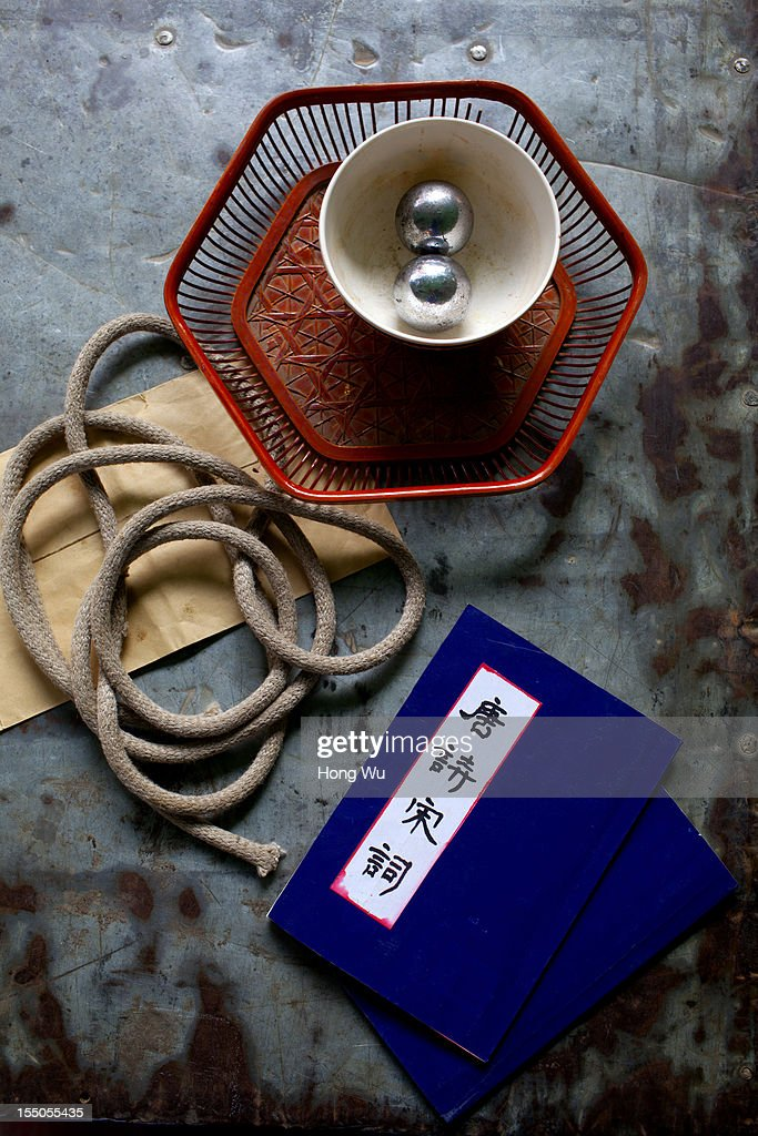 The belongings of Chinese Yu Opera performers are seen backstage on October 30, 2012 in Zhengzhou, China. As many as 60 performers from the Sanmenxia theatrical troupe are invited to perform Chinese traditional Yu Opera for local villagers in rural Zhengzhou city to celebrate the village's temple fair and earn 10,000 RMB yuan (US$ 1,600) each performance. Yu Opera, also called Henan Bangzi or Ou Opera, is one of the most popular local operas in China. Its earliest written record can be traced back more than 200 years and at the end of the Qing Dynasty (A.D. 1644-1911), the opera became widespread across the Henan province. After the establishment of the People's Republic of China in 1949, it experienced rapid growth not only in the villages and cities of Henan Province but also throughout the country. In recent years its popularity has declined due to young people's attraction to more modern cultures.
