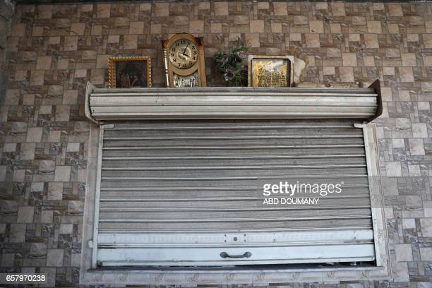 The belongings of Syrians displaced from the town of Maidaa are seen at their temporary homes in the town of Mesraba in the eastern Ghouta region a...