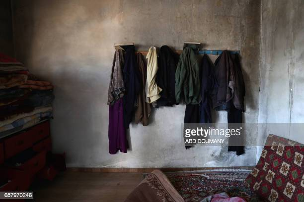TOPSHOT The belongings of Syrians displaced from the town of Maidaa are seen at their temporary homes in the town of Mesraba in the eastern Ghouta...