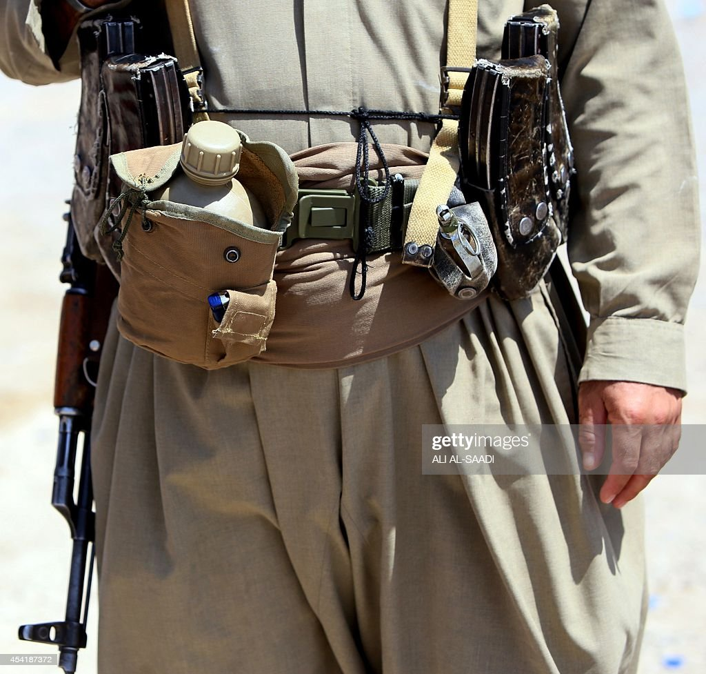 The belt of a Peshmerga fighter is seen as he stands guard at a post in the strategic Jalawla area, in Diyala province, which is a gateway to Baghdad, as battles with Islamic State (IS) jihadists continue on August 25, 2014. Kurdish forces backed by Iraqi air support retook three villages in the Jalawla area, as well as a main road used by jihadists to transport fighters and supplies, peshmerga members said.