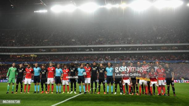 The Benfica and Manchester United team pose for a team photo with the match officals prior to the UEFA Champions League group A match between SL...