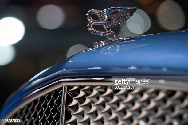 The Bentley hood ornament is pictured at the 2014 Paris Auto Show on October 3 2014 in Paris on the second of the two press days AFP PHOTO/JOEL SAGET