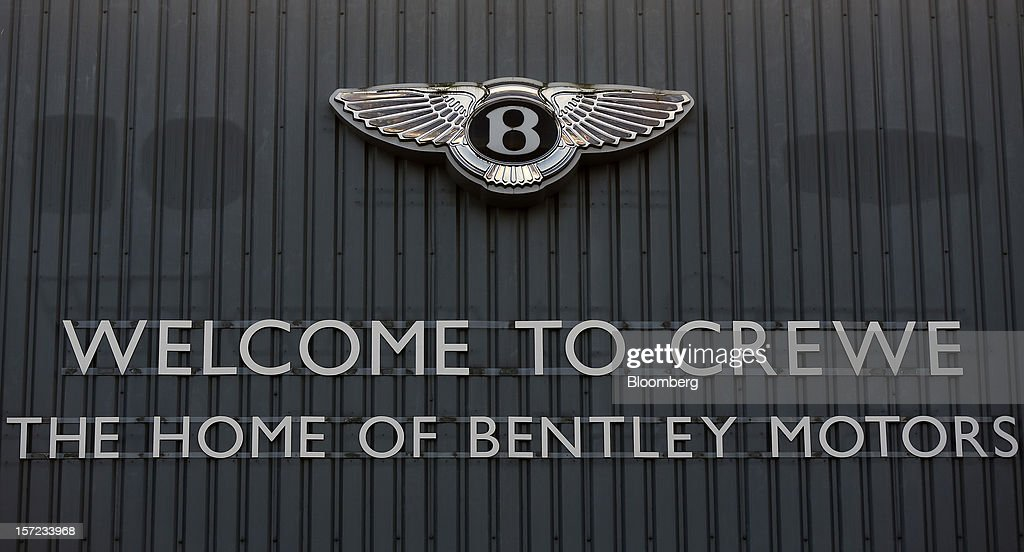 The Bentley Winged 'B' emblem sits on a wall at the Bentley Motors Ltd. workshop in Crewe, U.K., on Thursday, Nov. 29, 2012. Consumer spending and exports propelled the U.K. economy to its fastest growth since 2007 in the third quarter as the Olympics and a post-Jubilee rebound saw household expenditure rise the most in more than two years. Photographer: Simon Dawson/Bloomberg via Getty Images