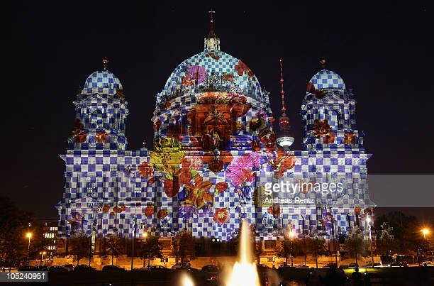 The Berlin Cathedral Church stands illuminated during the Festival of Lights on October 13 2010 in Berlin Germany Landmarks across Berlin will be...