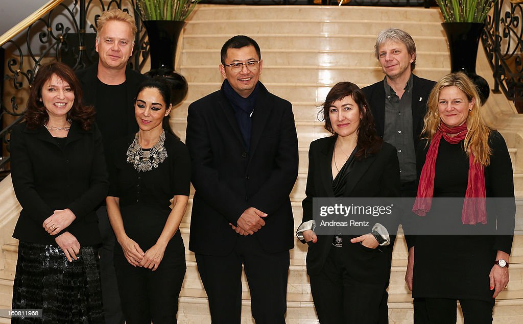 The Berlinale jury Suzanne Bier, <a gi-track='captionPersonalityLinkClicked' href=/galleries/search?phrase=Tim+Robbins&family=editorial&specificpeople=182439 ng-click='$event.stopPropagation()'>Tim Robbins</a>, <a gi-track='captionPersonalityLinkClicked' href=/galleries/search?phrase=Shirin+Neshat&family=editorial&specificpeople=3200877 ng-click='$event.stopPropagation()'>Shirin Neshat</a>, Wong Kar Wai (Jury-President), Athina Rachel Tsangari, Andreas Dresen and <a gi-track='captionPersonalityLinkClicked' href=/galleries/search?phrase=Ellen+Kuras&family=editorial&specificpeople=243051 ng-click='$event.stopPropagation()'>Ellen Kuras</a> attend a photocall for the 63rd Berlinale International Film Festival at Ritz Carlton Hotel on February 6, 2013 in Berlin, Germany.
