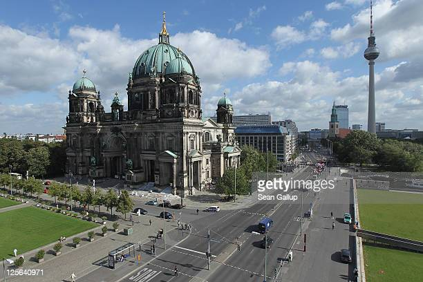 The Berliner Dom cathedral stands near Alexanderplatz square and the Berliner Fernsehturm broadcast tower on September 14 2011 in Berlin Germany Both...