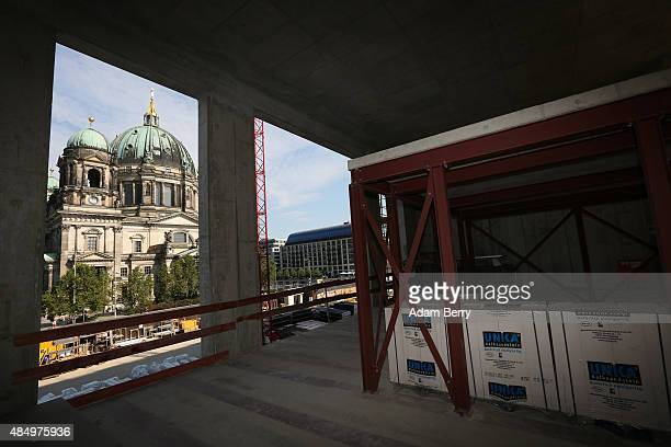 The Berliner Dom or cathedral is seen through the construction site of the Berliner Schloss city palace on August 23 2015 in Berlin Germany The...