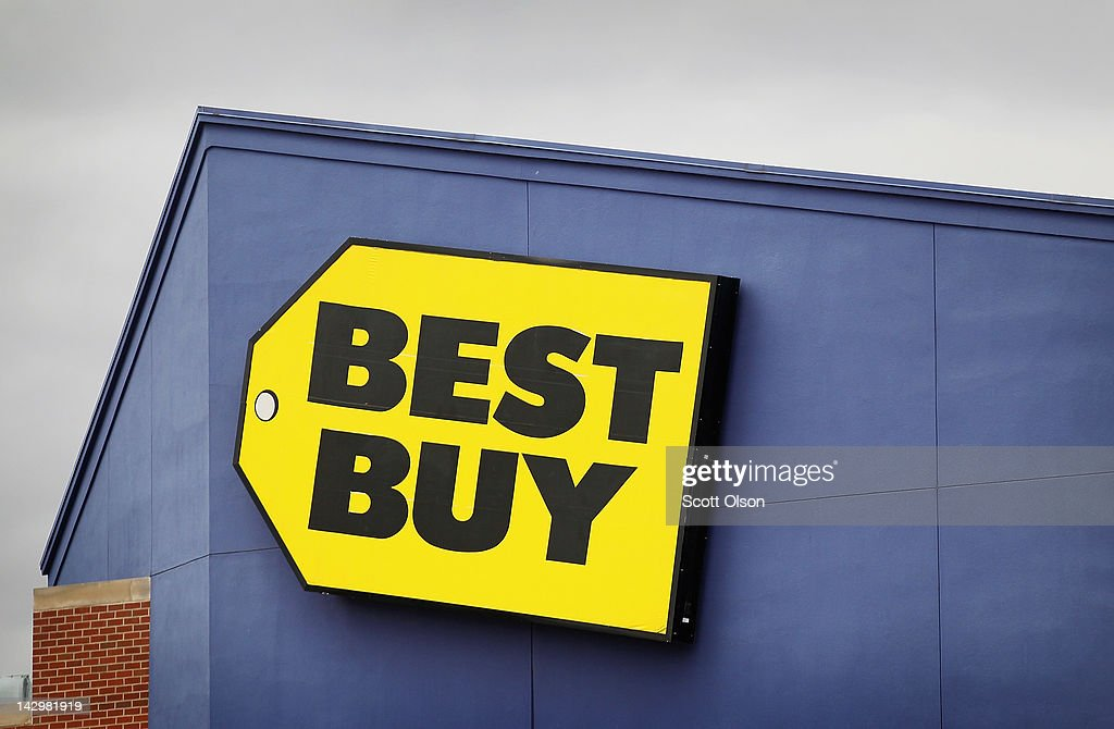 The Best Buy logo hangs above a store on April 16, 2012 in Chicago, Illinois. The struggling electronics retailer plans to close 50 stores nationwide in an attempt to cut $250 million in costs for the 2013 fiscal year.