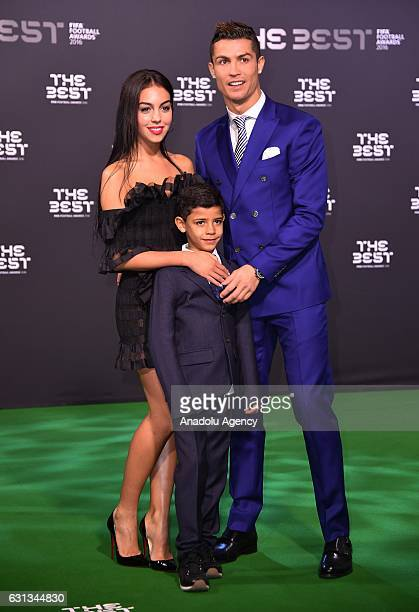 The Best FIFA Men's Player Award nominee Real Madrid's Cristiano Ronaldo with his son arrives for the The Best FIFA Football Awards at TPC Studio in...