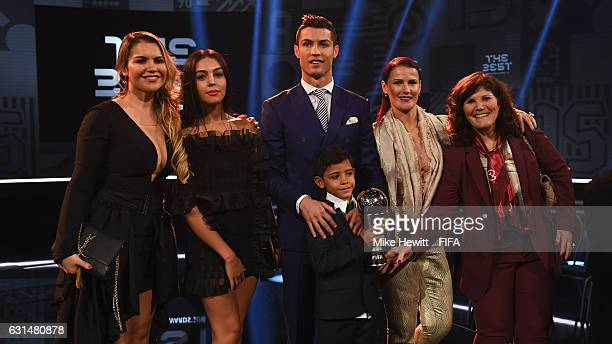 The Best FIFA Men's Player Award winner Cristiano Ronaldo of Portugal and Real Madrid poses with Georgina Rodriguez his mother Maria Dolores dos...