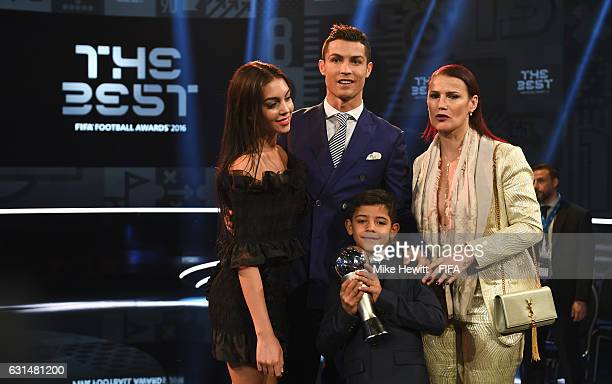 The Best FIFA Men's Player Award winner Cristiano Ronaldo of Portugal and Real Madrid poses with Georgina Rodriguez his sister and son Cristiano...
