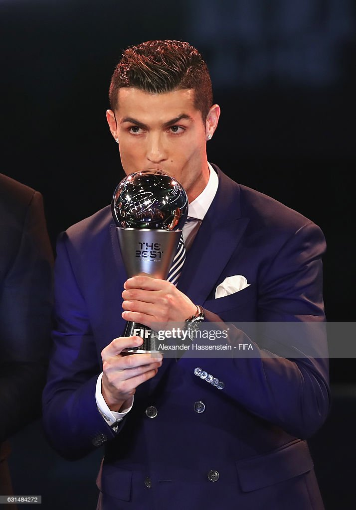 The Best FIFA Men's Player Award winner Cristiano Ronaldo of Portugal and Real Madrid kisses the trophy during The Best FIFA Football Awards at TPC Studio on January 9, 2017 in Zurich, Switzerland.