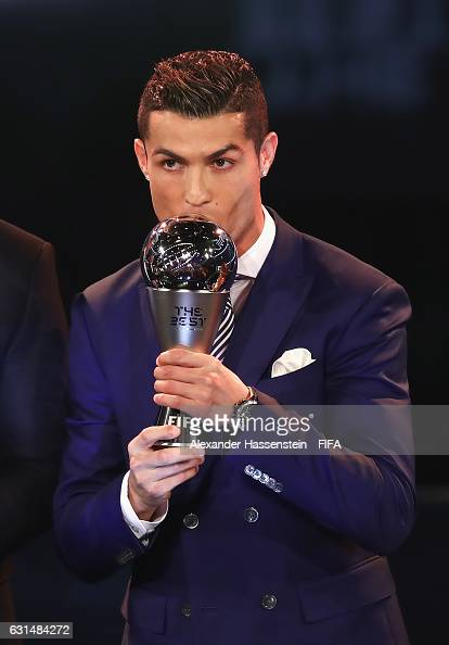 The Best FIFA Men's Player Award winner Cristiano Ronaldo of Portugal and Real Madrid kisses the trophy during The Best FIFA Football Awards at TPC...