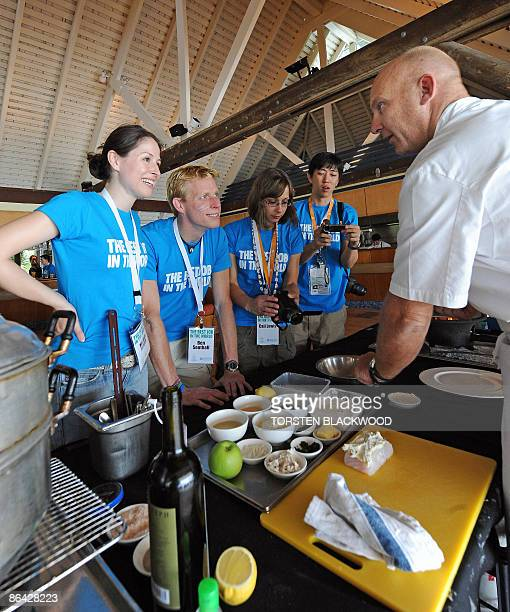 The 'Best Job In The World' finalists Mirjam Novak Ben Southall Cali Lewis and Juweon Kim learn to steam coral trout with 'Aria' head chef Matt Moran...