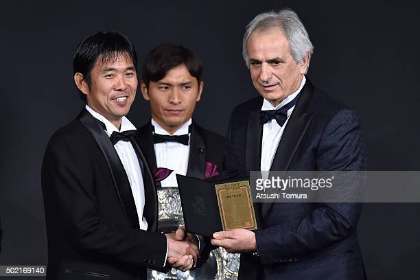 The best mamager of the year Hajime Moriyasu head coach of Sanfrecce Hiroshima receives his award from Japan national team head coach Vahid...