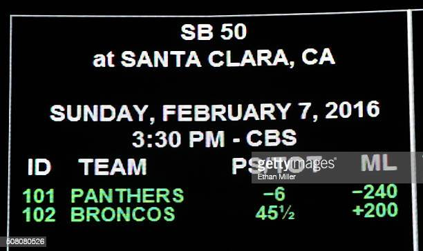 The betting line for Super Bowl 50 between the Carolina Panthers and the Denver Broncos is displayed at the Race Sports SuperBook at the Westgate Las...
