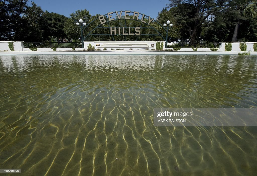 The Beverly Hills lily pond with the city's famous sign is seen during a severe drought in Beverly Hills California on April 9 2015 On average...