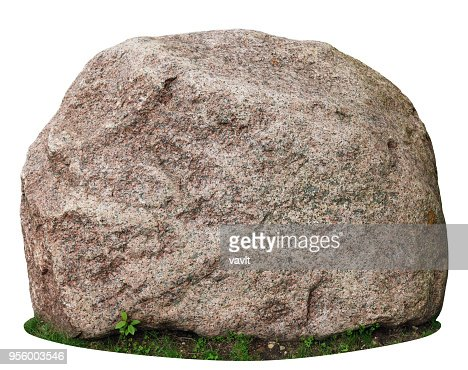 The big ancient mossy granite stone lie on a forest green grass glade. : Stock Photo