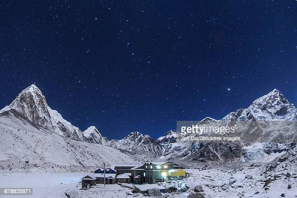 the Big Dipper rise above the Himalayas and the Gorak Shep settlement in Nepal.