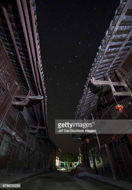 The Big Dipper seen through the alley way of a street in China.