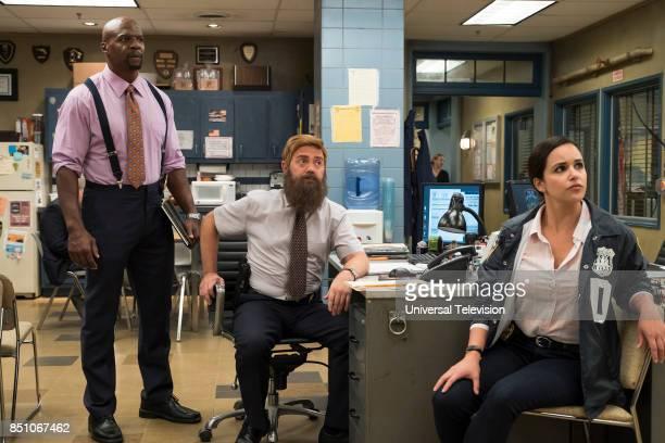 NINE 'The Big House Pt 2' Episode 502 Pictured Terry Crews as Terry Jeffords Joe Lo Truglio as Charles Boyle Melissa Fumero as Amy Santiago