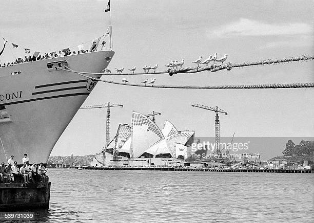 The Big Picture Crowds on board the cruise ship Marconi and on the wharf at the Overseas Passenger Terminal await the arrival of US President Lyndon...