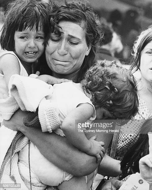 The Big Picture Two days after Cyclone Tracy hit Darwin on Christmas Eve 1974 the strain shows on the face of this woman as she carries her two...