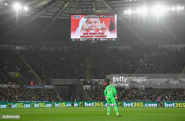 The big screen shows Bradley Lowery during the Premier League match between Swansea City and Sunderland at Liberty Stadium on December 10 2016 in...