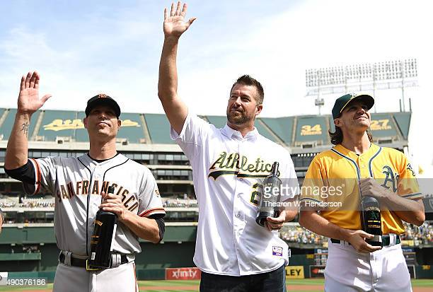 The Big Three Barry Zito of the Oakland Athletics former Oakland Athletics Mark Mulder and Tim Hudson of the San Francisco Giants is presented with a...