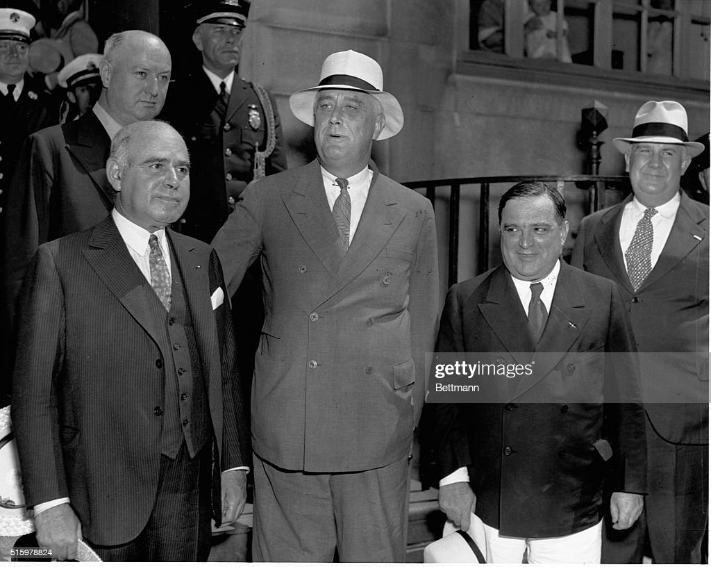 The 'Big Three' of the Triborough Bridge project in New York. President Franklin D. Roosevelt (front center), whose New Deal fathered the project, Governor <a gi-track='captionPersonalityLinkClicked' href=/galleries/search?phrase=Herbert+H.+Lehman&family=editorial&specificpeople=212760 ng-click='$event.stopPropagation()'>Herbert H. Lehman</a> (front left), who was governor throughout the bridge construction, and Mayor <a gi-track='captionPersonalityLinkClicked' href=/galleries/search?phrase=Fiorello+La+Guardia&family=editorial&specificpeople=93387 ng-click='$event.stopPropagation()'>Fiorello La Guardia</a> (front right), fusionist mayor of New York, who cooperated in the bridge construction, gather on the steps of Roosevelt's town house, just prior to the Triborough Bridge dedication ceremony. Postmaster General <a gi-track='captionPersonalityLinkClicked' href=/galleries/search?phrase=James+A.+Farley&family=editorial&specificpeople=213263 ng-click='$event.stopPropagation()'>James A. Farley</a> (left) is behind Governor Lehman.