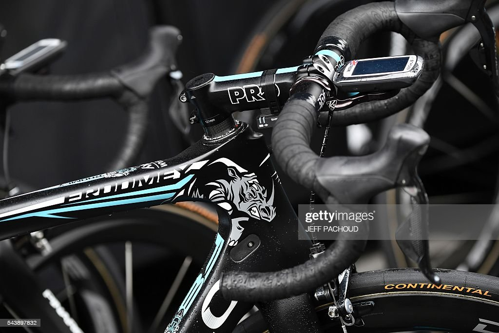 The bike of Great Britain's Christopher Froome reading his nickname 'Froomey' is pictured at the hotel of the Great Britain's Sky cycling team, in Port-en-Bessin-Huppain on July 30, 2016, two days before the start of the 103rd edition of the Tour de France cycling race. The 2016 Tour de France will start on July 2 in the streets of Le Mont-Saint-Michel and ends on July 24, 2016 down the Champs-Elysees in Paris. / AFP / jeff pachoud