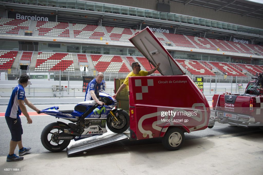 The bike of <a gi-track='captionPersonalityLinkClicked' href=/galleries/search?phrase=Jorge+Lorenzo&family=editorial&specificpeople=543869 ng-click='$event.stopPropagation()'>Jorge Lorenzo</a> of Spain and Movistar Yamaha MotoGP returns to box with marshall during the MotoGp Tests In Montmelo at Circuit de Catalunya on June 16, 2014 in Montmelo, Spain.