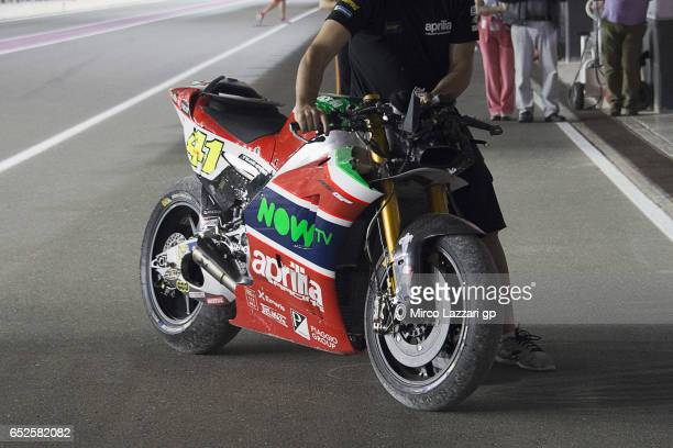 The bile of Aleix Espargaro of Spain and Aprilia Racing Team Gresini returns in box with mechanic after crashed out during the MotoGP Tests In Losail...