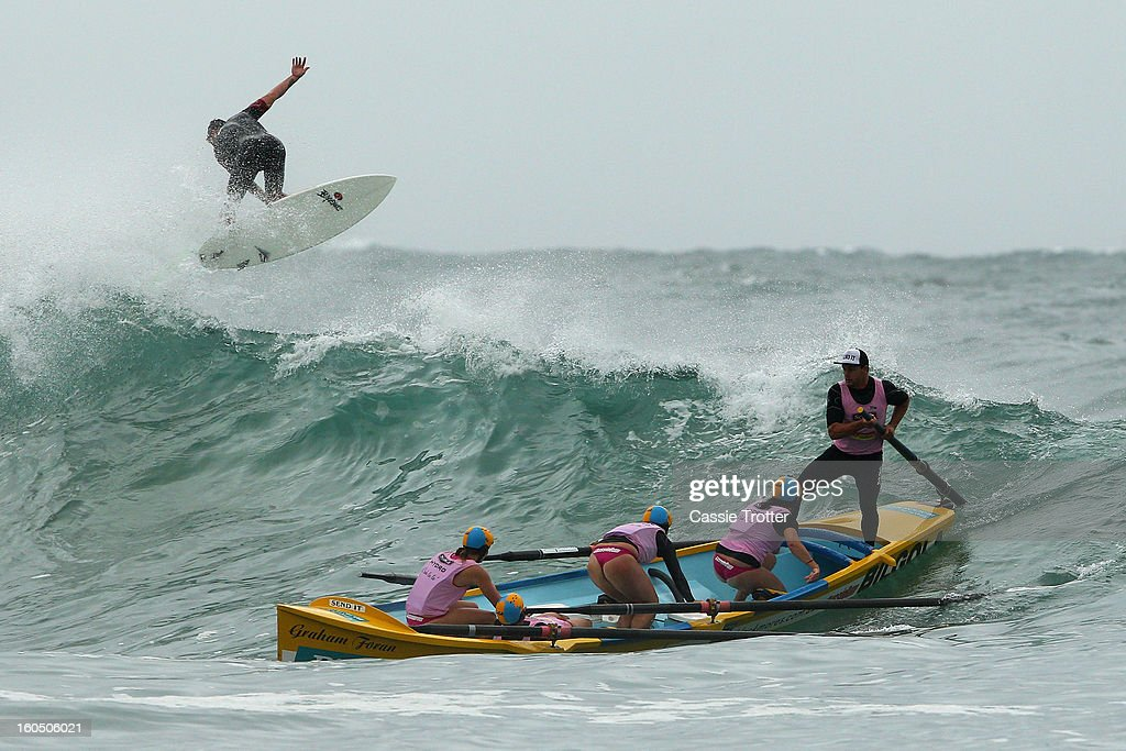 The Bilgoa women's surf life saving crew paddle through a wave during the Ocean Thunder Surf Boat Series at Dee Why Beach on February 2, 2013 in Sydney, Australia.