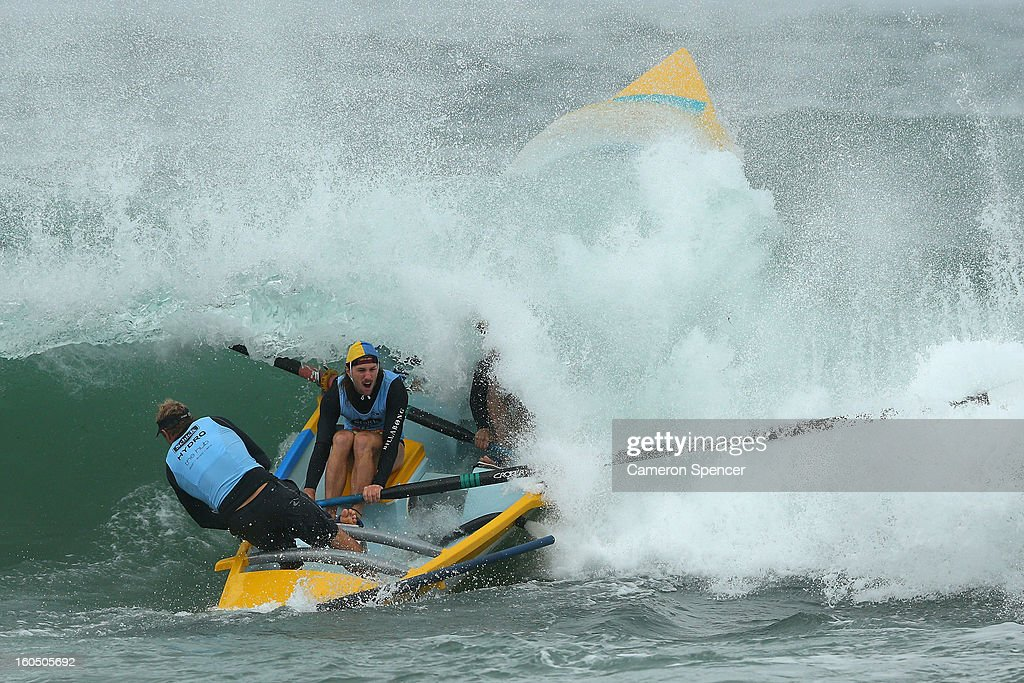 The Bilgola suf life saving crew paddle through a wave during the Ocean Thunder Surf Boat Series at Dee Why Beach on February 2, 2013 in Sydney, Australia.