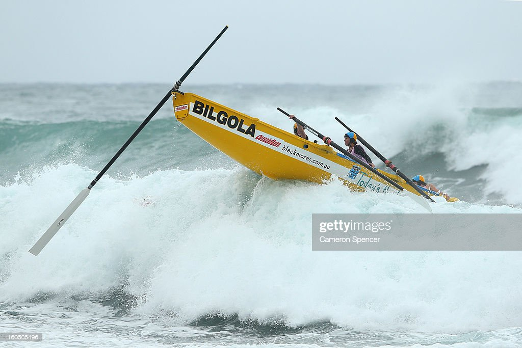 The Bilgola womens suf life saving crew launch over a wave during the Ocean Thunder Surf Boat Series at Dee Why Beach on February 2, 2013 in Sydney, Australia.