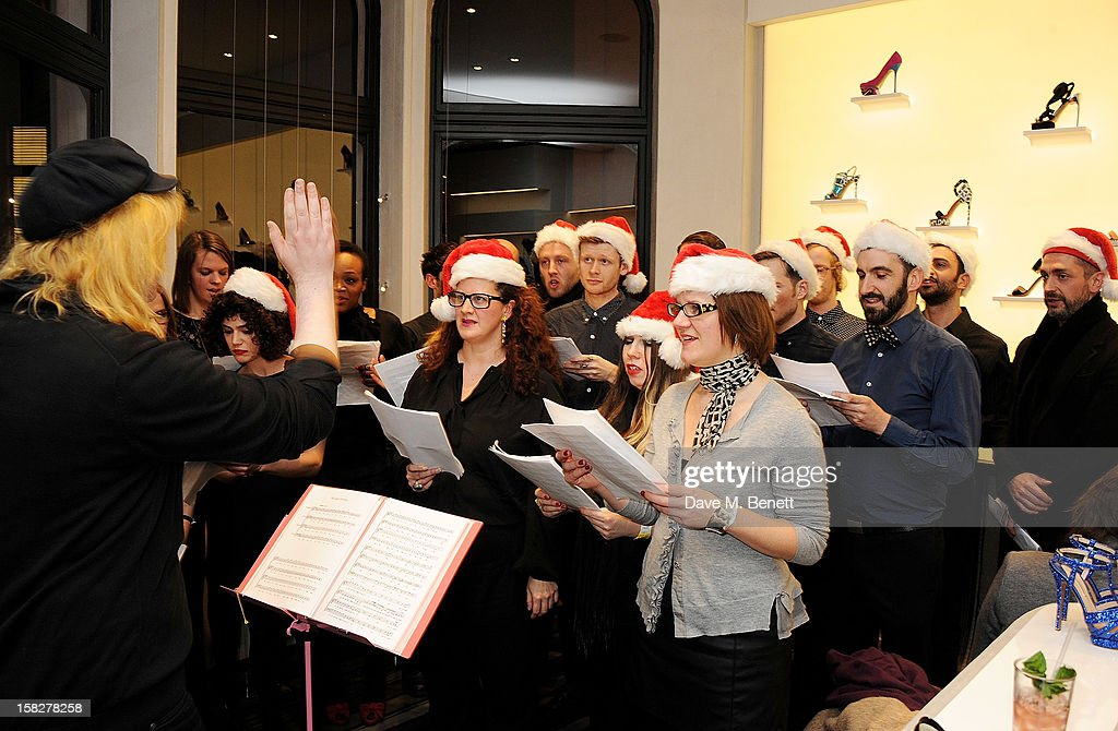 The Bistotheque Choir performs at a Christmas drinks hosted by designer Nicholas Kirkwood to celebrate his partnership with Chambord black raspberry liquer, and launch the limited edition shoe 'The Chambord' at the Nicholas Kirkwood Mount Street store on December 12, 2012 in London, England.