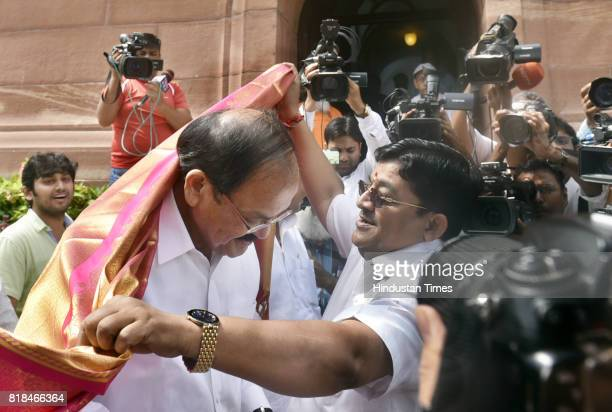 The BJP candidate Venkaiyah Naidu being given warm welcome as arrives to file his nomination for the vice president At Parliament House on July 18...